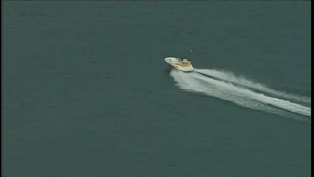 wjw aerial of man driving speedboat on lake erie near cleveland ohio on july 27 2017 - lago erie video stock e b–roll