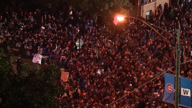 aerial of massive crowd outside wrigley field after the chicago cubs won their first mlb national league championship series and advanced to the... - baseball world series stock videos & royalty-free footage