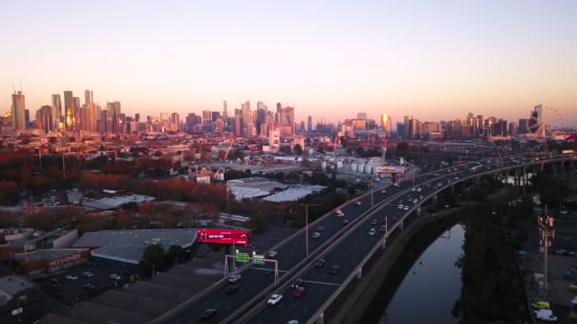 aerial of melbourne cbd at sunset with citylink freeway - skyline stock videos & royalty-free footage