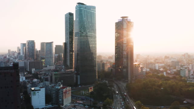 vidéos et rushes de aerial of mexico city traffic and high-rises at sunrise - mexico