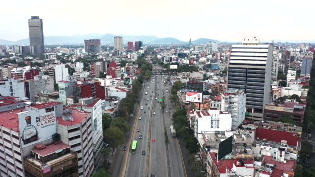 aerial of mexico city traffic and high-rises - avenue stock videos & royalty-free footage