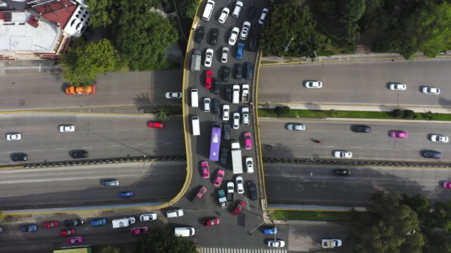 aerial of mexico city traffic from above - ingorgo stradale video stock e b–roll