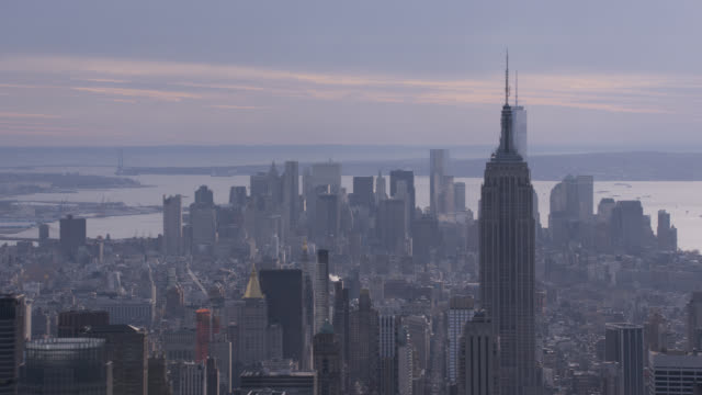 aerial of midtown manhattan new york city skyline with skyscrapers and high rise office or apartment buildings. empire state building and chrysler building. - world trade centre manhattan stock videos and b-roll footage