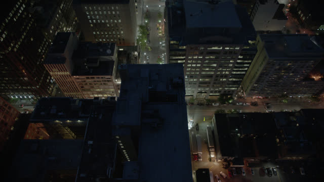 Aerial OF MINI-COOPERS DRIVING ON CITY STREET. OFFICE BUILDINGS AND HIGH RISES VISIBLE.