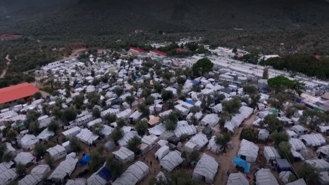 aerial of moria refugee camp in lesbos greece - flüchtling stock-videos und b-roll-filmmaterial