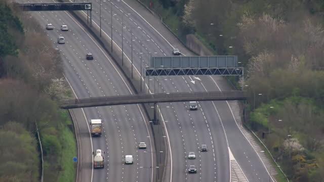 aerial of motorways looking busier now in coronavirus lockdown than when lockdown first began - major road stock videos & royalty-free footage