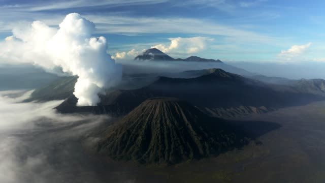 aerial of mount bromo active volcano - atmospheric mood stock videos & royalty-free footage