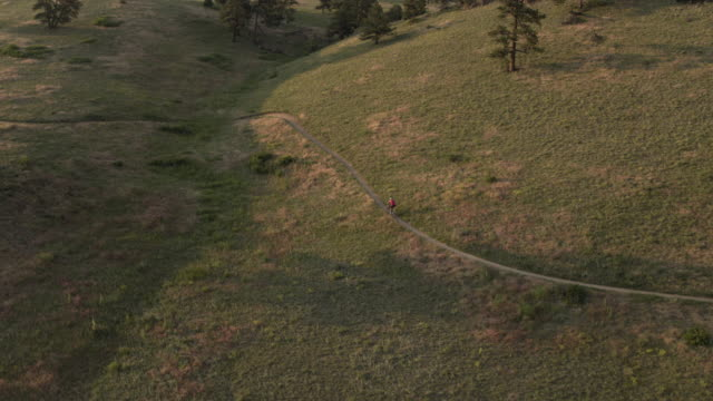 Aerial of mountain biker riding up trail Part3