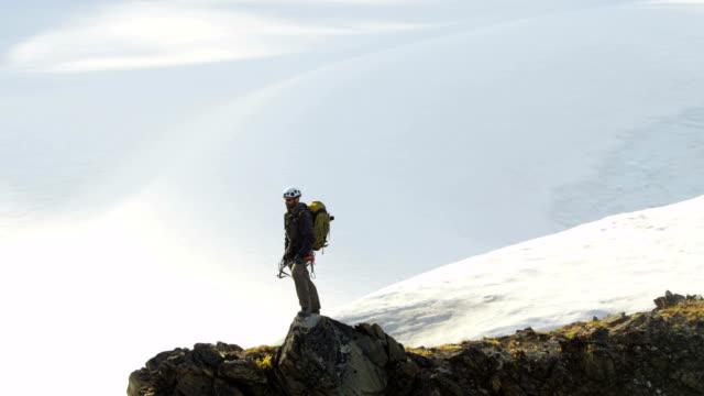 Aerial of mountain peak climber Alaska USA