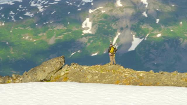 aerial of mountain peak climber alaska usa - mountain ridge stock videos & royalty-free footage
