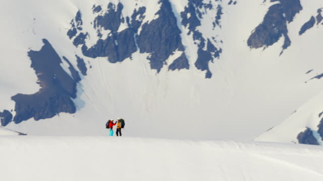 Aerial of mountaineers on snow covered mountain Alaska