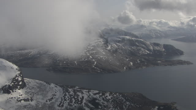 aerial of mountains and fjord - fjord stock videos & royalty-free footage