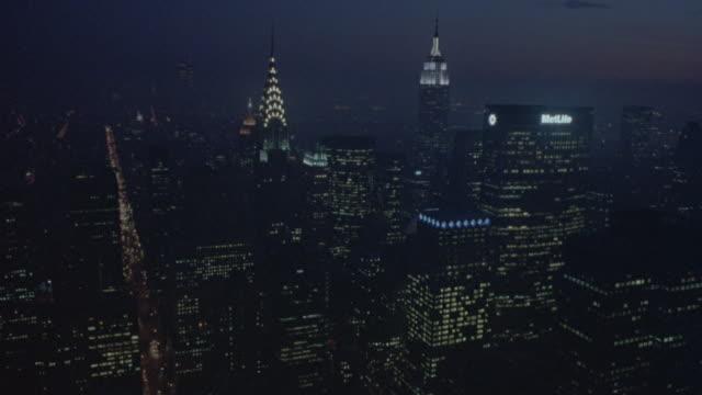 aerial of new york city skyline at night. - citigroup center manhattan stock videos & royalty-free footage