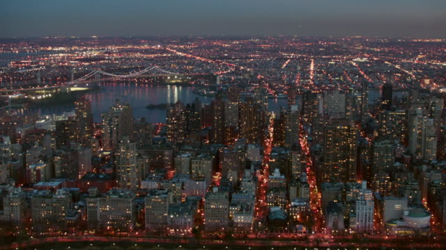 aerial of north east end of central park looking out at upper east side and queens at night, nyc - harlem stock videos & royalty-free footage
