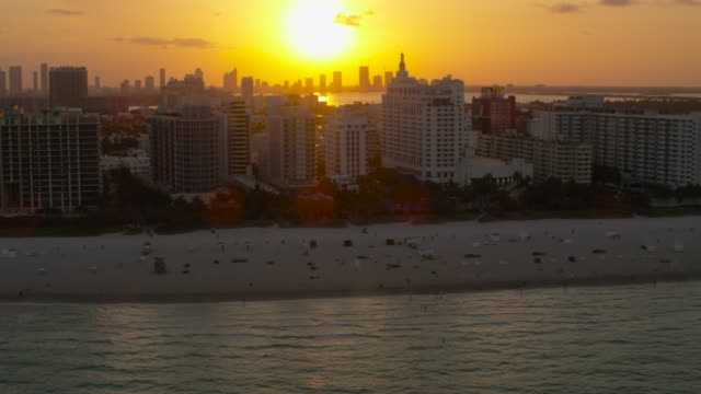 aerial of ocean, beach, buildings and hotels south beach sunset miami, fl - 1 minute or greater stock videos & royalty-free footage