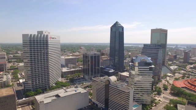 aerial of office buildings in downtown jacksonville florida with a nice blue sky in the background filmed at 60fps allowing for smooth slow motion... - wells fargo stock videos and b-roll footage
