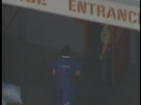 aerial of oj simpson exiting van and walking across lot to jail - crime or recreational drug or prison or legal trial stock-videos und b-roll-filmmaterial