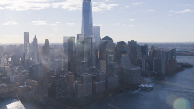 aerial of one world trade center or freedom tower and four world trade center. modern glass building. skyscrapers and high rise office or apartment buildings in downtown manhattan new york city skyline. - world trade centre manhattan stock videos and b-roll footage