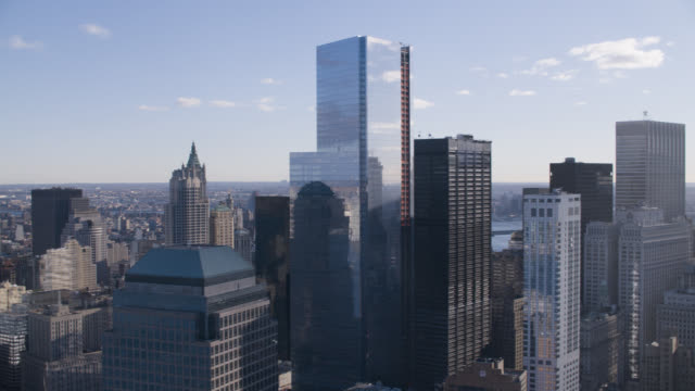 aerial of one world trade center or freedom tower and four world trade center. modern glass building. skyscrapers and high rise office or apartment buildings in downtown manhattan new york city skyline.