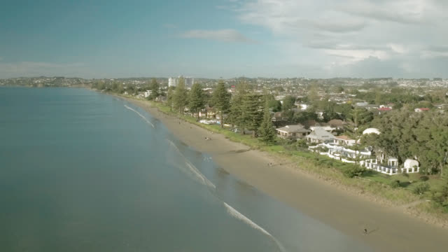 aerial of orewa beach - south pacific ocean stock videos & royalty-free footage