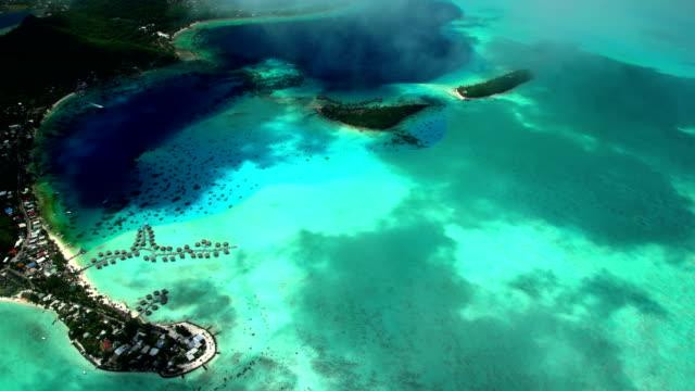 aerial of overwater bungalows matira point bora bora - polynesischer abstammung stock-videos und b-roll-filmmaterial