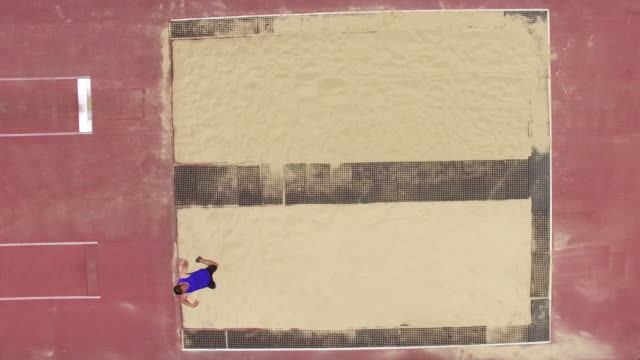 Aerial of Paralympic athlete practicing long jump