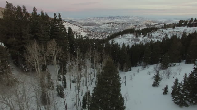 4k aerial of park city, utah in the winter with snow on the ground - park city utah video stock e b–roll