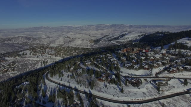 4k aerial of park city, utah in the winter with snow on the ground - hügelkette stock-videos und b-roll-filmmaterial
