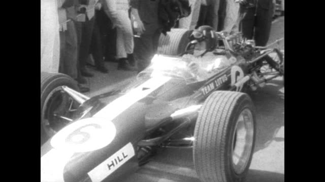 aerial of parked cars at the american grand prix in new york / driver jim clark / dennis hulme in his formula 1 car / jack brabham getting into his... - 1967 stock videos & royalty-free footage