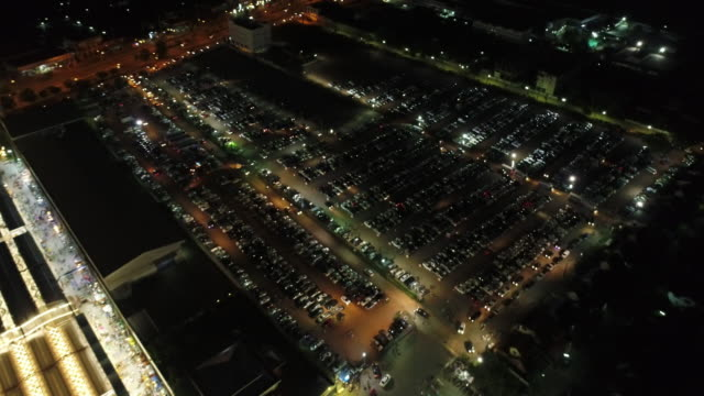 aerial of parking at night - parking stock videos & royalty-free footage
