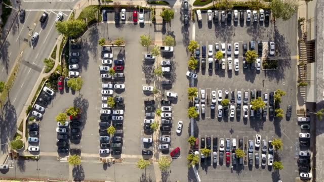 aerial of parking lot - parking stock videos & royalty-free footage