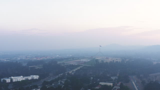 aerial of parliament house and canberra area engulfed in bushfire smog and pollution - canberra stock videos & royalty-free footage