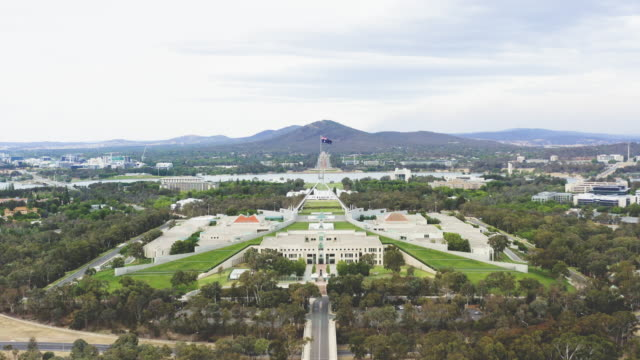 aerial of parliament house and canberra area - united states congress stock-videos und b-roll-filmmaterial
