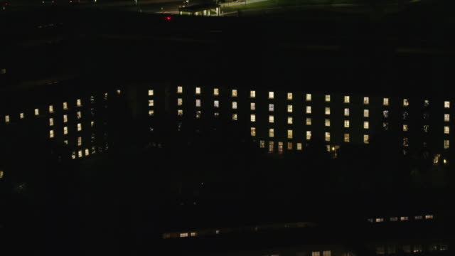 Aerial of Pentagon at night with lights on, Washington DC