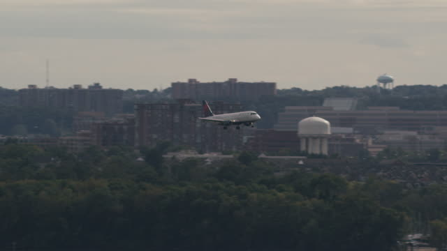 aerial of plane landing ronald reagan washington national airport - ronald reagan washington national airport stock videos and b-roll footage