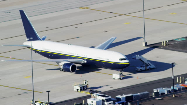 aerial of plane parked at ronald reagan washington national airport - ronald reagan washington national airport stock videos and b-roll footage