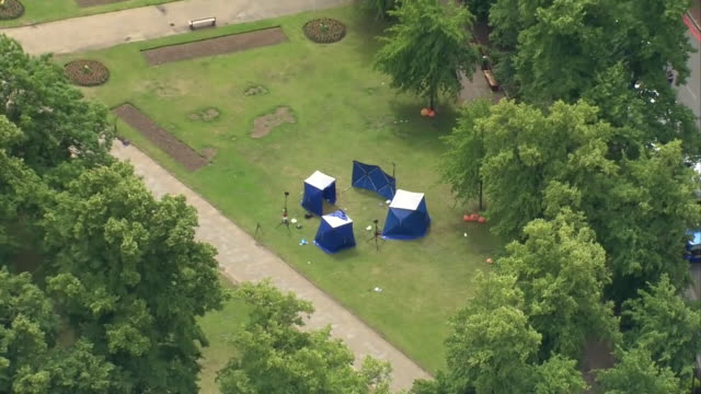 aerial of police tents in forbury gardens, reading, where three men. were killed during a knife attack that is being classed as a terrorist incident - criminal investigation stock videos & royalty-free footage