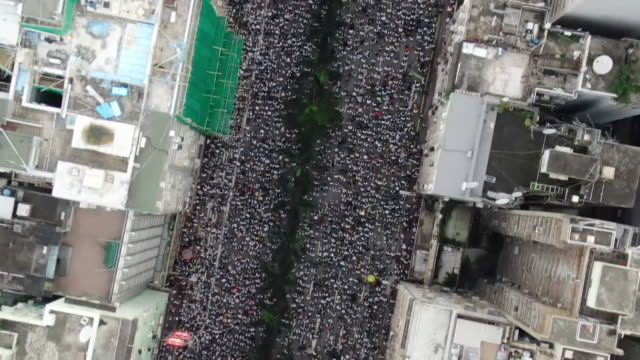 aerial of protest march in hong kong over extradition bill on the 9th june - hong kong stock videos & royalty-free footage