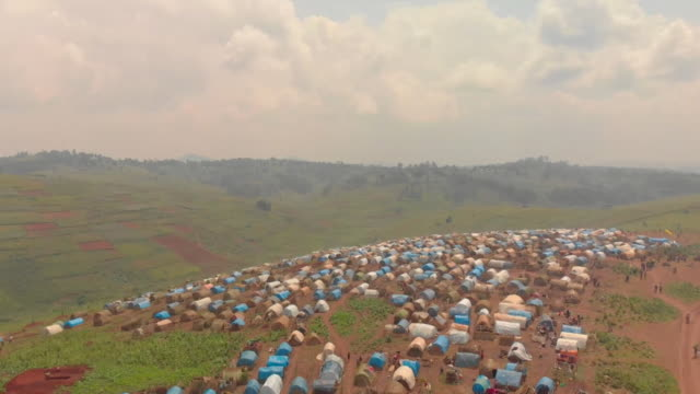 aerial of refugee camp in beni, democratic republic of congo, for displaced people due to ebola and war - democratic republic of the congo stock videos & royalty-free footage