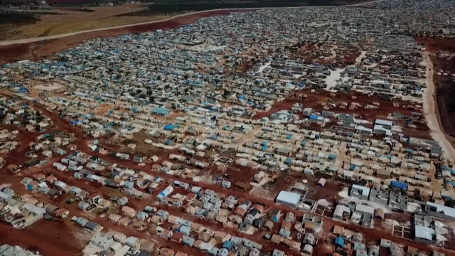 stockvideo's en b-roll-footage met aerial of refugee camp on idlib syria for families displaced by the syrian civil war - vluchteling ontheemden