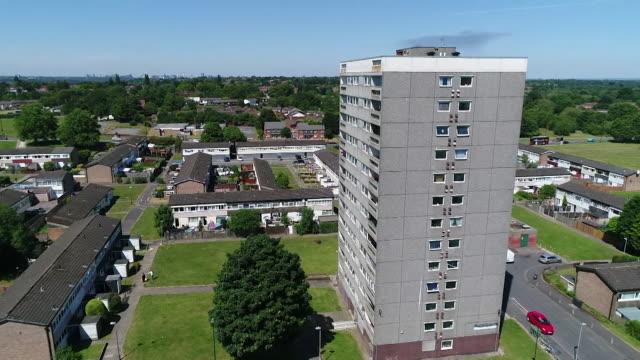 aerial of residential tower block in birmingham during coronavirus lockdown - flat stock videos & royalty-free footage
