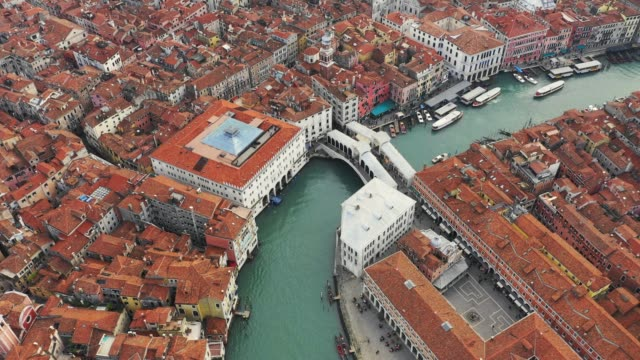 aerial of rialto bridge and city of venice, italy - canal stock videos & royalty-free footage