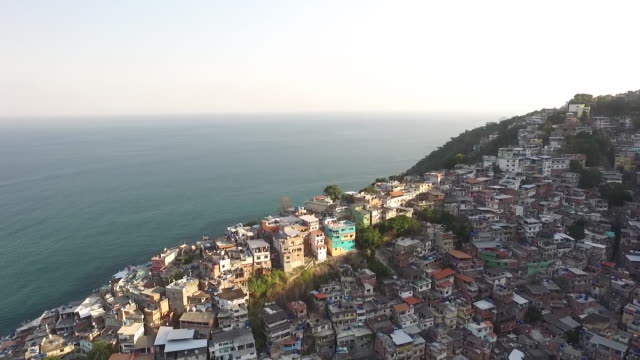 aerial of rio de janerio town and coast - favela stock videos and b-roll footage