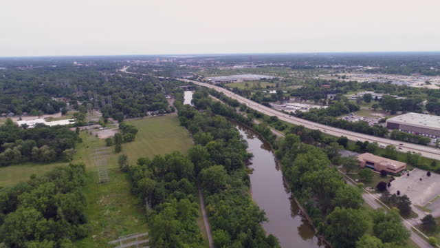 aerial of river in flint, michigan - michigan stock videos & royalty-free footage