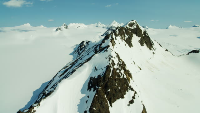 Aerial of rugged glacial mountains and snow Alaska
