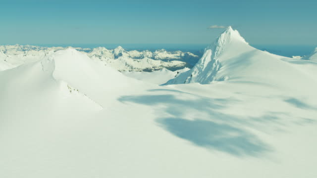 aerial of rugged glacial mountains and snow alaska - ridge stock videos & royalty-free footage