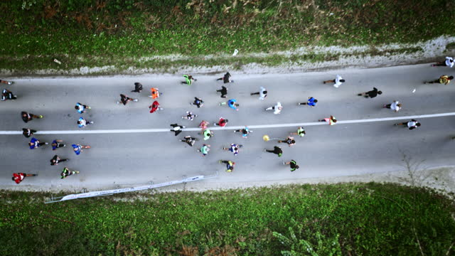 Aerial of runners at the marathon running on countryside road