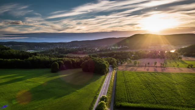 vídeos de stock e filmes b-roll de aerial of rural landscape in backlight, hesse, germany - back lit