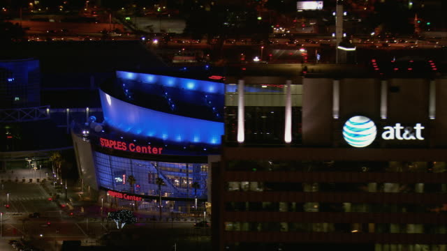 aerial of la's staples center at night - staples centre stock videos & royalty-free footage