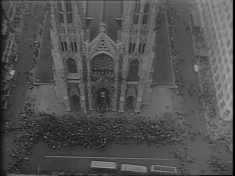 aerial of saint patrick's cathedral, crowds outside on the steps way below / crowds holding umbrellas on fifth avenue / close-up on mister and misses... - knights templar stock videos & royalty-free footage